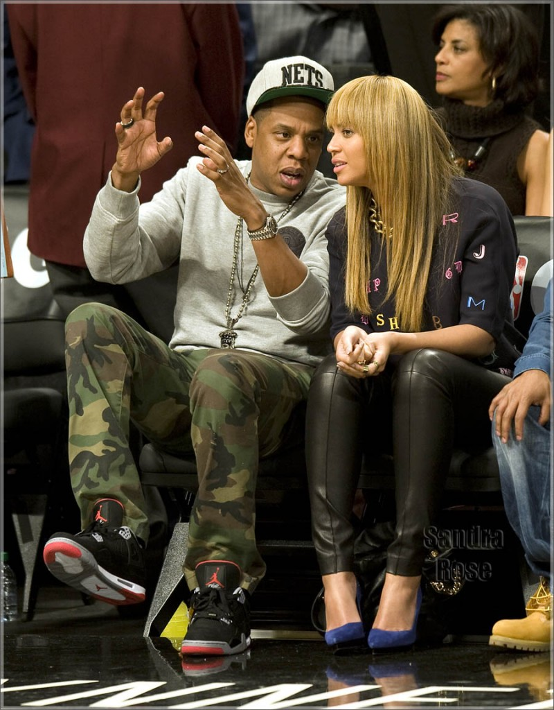Jay Z and Beyonce with Michael Strahan sit court side for the NY Knicks vs Brooklyn Nets showdown